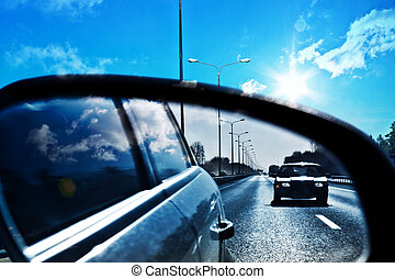 rearview mirror - catching the car on the highway, in the...