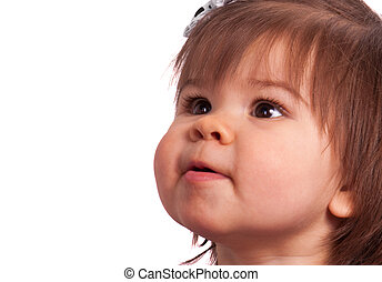expectation - little girl with brown hair looks upward on a...