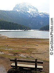 Durmitor Montenegro - Empty bench at Crno lake and Durmitor...