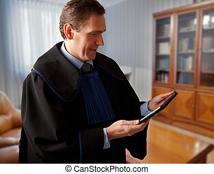 Attorney with tablet - Attorney wearing classic gown with...