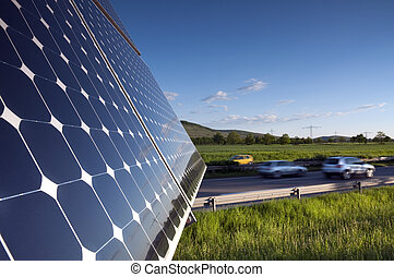Solar Panel Against Blue Sky With Green Landscape And...