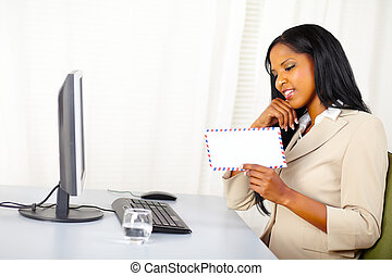 Businesswoman looking to a letter