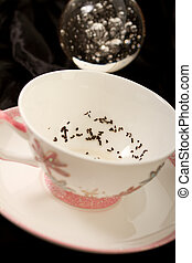 Fortune telling - tea leaves at the bottom of a cup