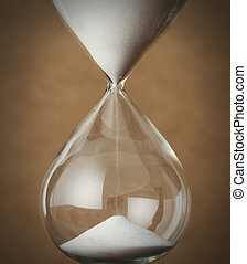 time concept: vintage hourglass close up