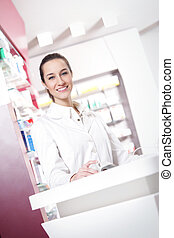 female pharmacist - portrait of a female pharmacist at...