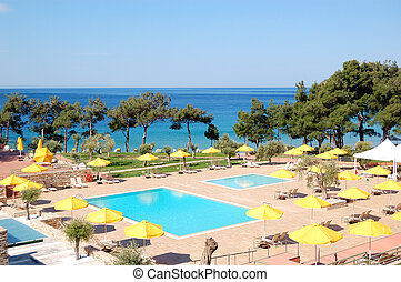 Swimming pool by a beach at the modern luxury hotel, Thassos...