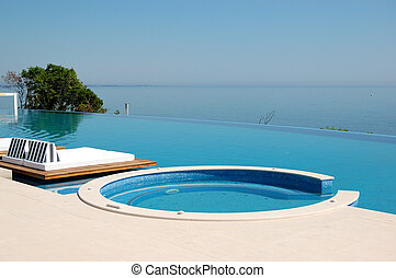 Infinity swimming pool  with jacuzzi by beach at the modern luxury hotel, Pieria, Greece