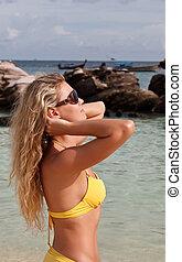pretty woman in bikini and glasses - Young pretty woman in...