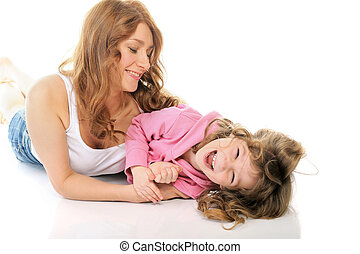 cheerful girl hugs her young mother.