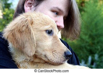 Teen Boy And Golden Puppy 3 - Closeup of a smiling teenage...