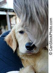 Teen Boy Kissing Golden Puppy