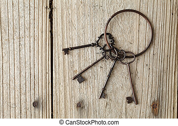 Antique key - Old key on wooden background