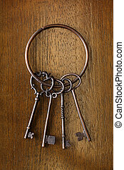 Old key on wooden background