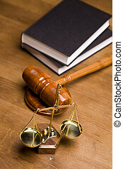 Law Concept - Scales of justice and gavel on desk with dark...