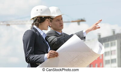 Construction site inspectors - Businesspeople wearing...