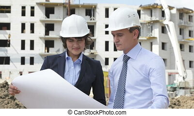 Supervisors onsite - Two supervisors at construction site...