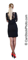 back view of standing beautiful blonde business woman