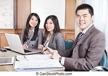 Group of business people smiling - Group of Chinese business...