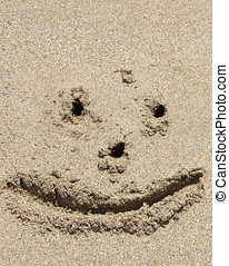 Smiley Face drawing on the beach