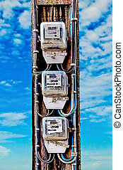 The Old electric meter on blue sky background