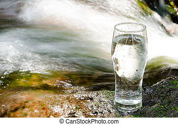 Brook and glass - Swift flow of brook and glass water