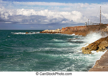 Waves on Mediterranean sea - Waves on wave breakers under...