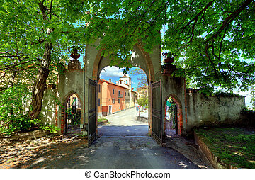Old Gate Novello, Northern Italy - Old gate under the trees...