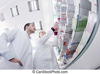 pharmacy drugstore people team - team of pharmacist chemist...