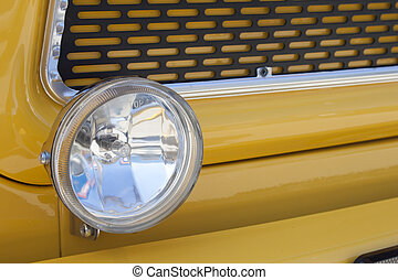Yellow car head lights Auto Show