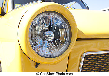 Yellow car head lights. Auto Show.