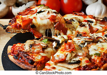 Ham and Mushroom Pizza - serving slice of ham and mushroom...