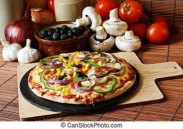 Vegetable Pizza - Vegetarian pizza with a topping of...