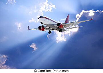 sun behind and airplane - Airplane and Sun rays going...