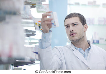 pharmacist chemist man in pharmacy drugstore - portrait of...