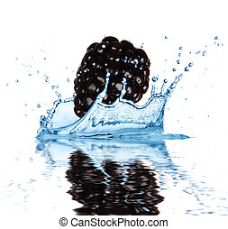 Fruit falling into water - Blackberry falling into water,...