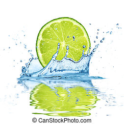 Fruit falling into water - Slice of lime falling into water,...