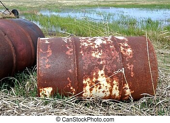 Pollution, old rusty barrels. - Rusty old metal drums dumped...