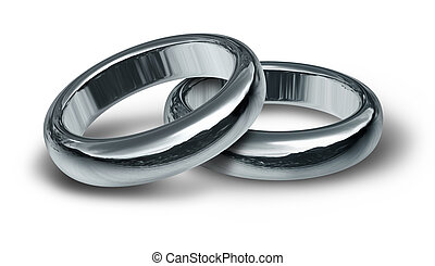 Two Silver Wedding Rings - Two silver wedding rings resting...