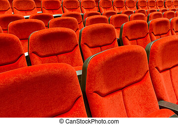 Theater seats - Rows of red velvet theater seating.