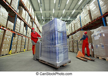 Warehousing optimization - work - Two workers in uniforms...
