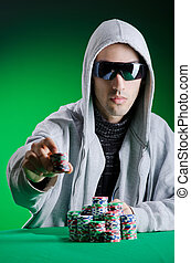 Player in casino and chips