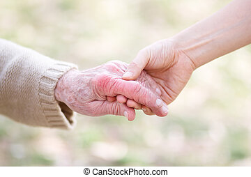 Senior and Young Women Holding Hands