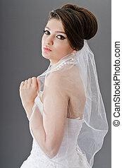 Bride in wedding dress in studio shooting