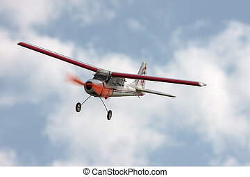 RC model airplane flying in the blue sky, closeup