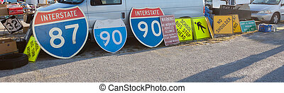 Signs - Variety of highway signs on sale at a flea market
