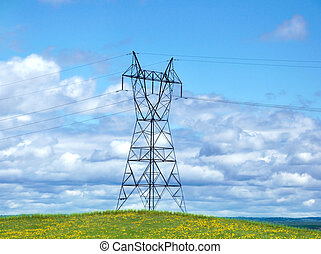 Power Tower On A Hill Against A Blue Sky