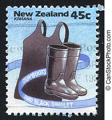 Black singlet and gumboots - NEW ZEALAND - CIRCA 1994: stamp...