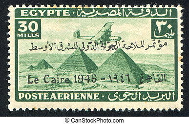 Airplane over Giza Pyramids - EGYPT - CIRCA 1931: stamp...