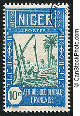 Drawing Water - NIGER - CIRCA 1926-1940: stamp printed by...