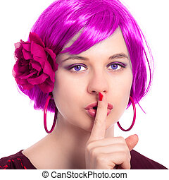 Beautiful woman in pink wig gesturing silence